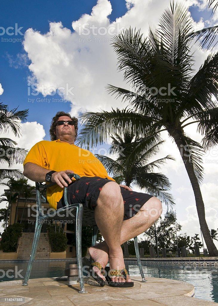 Wealthy man at his mansion backyard stock photo