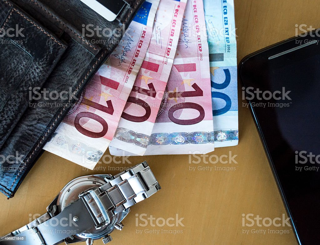 Wealthy Scene of Euros/Cash, Wallet, Watch, Phone royalty-free stock photo