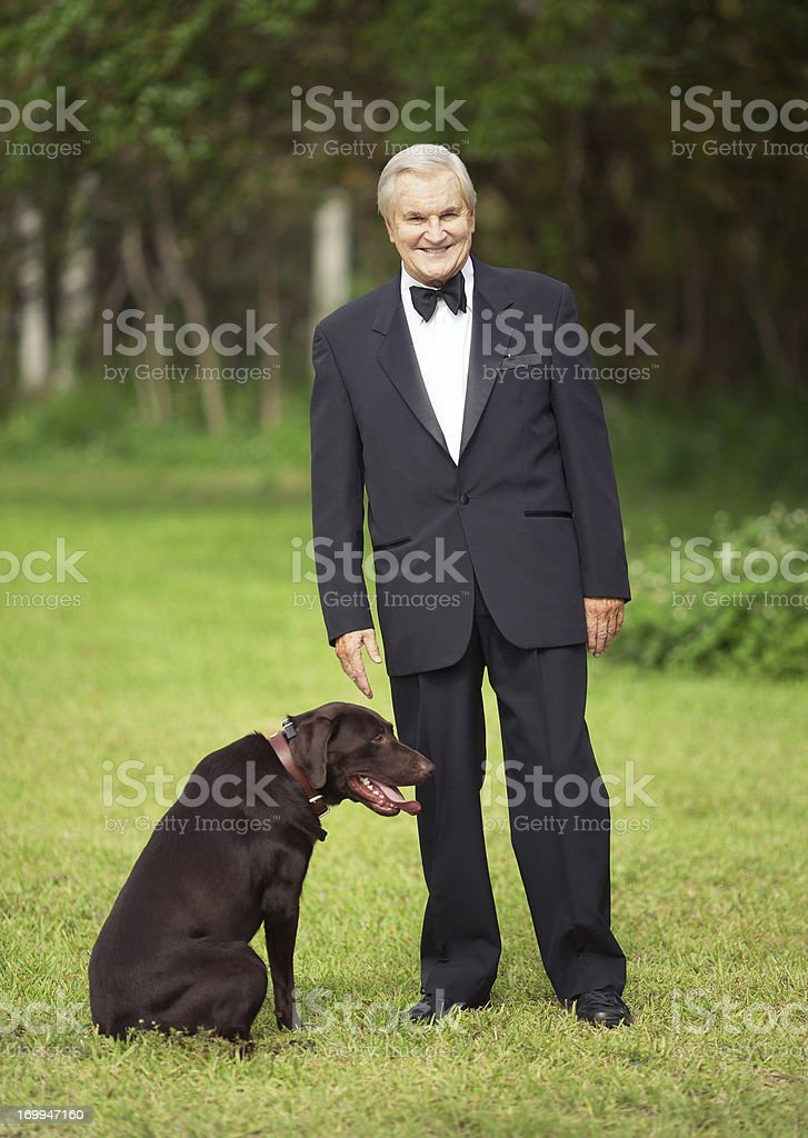 wealthy senior with dog stock photo