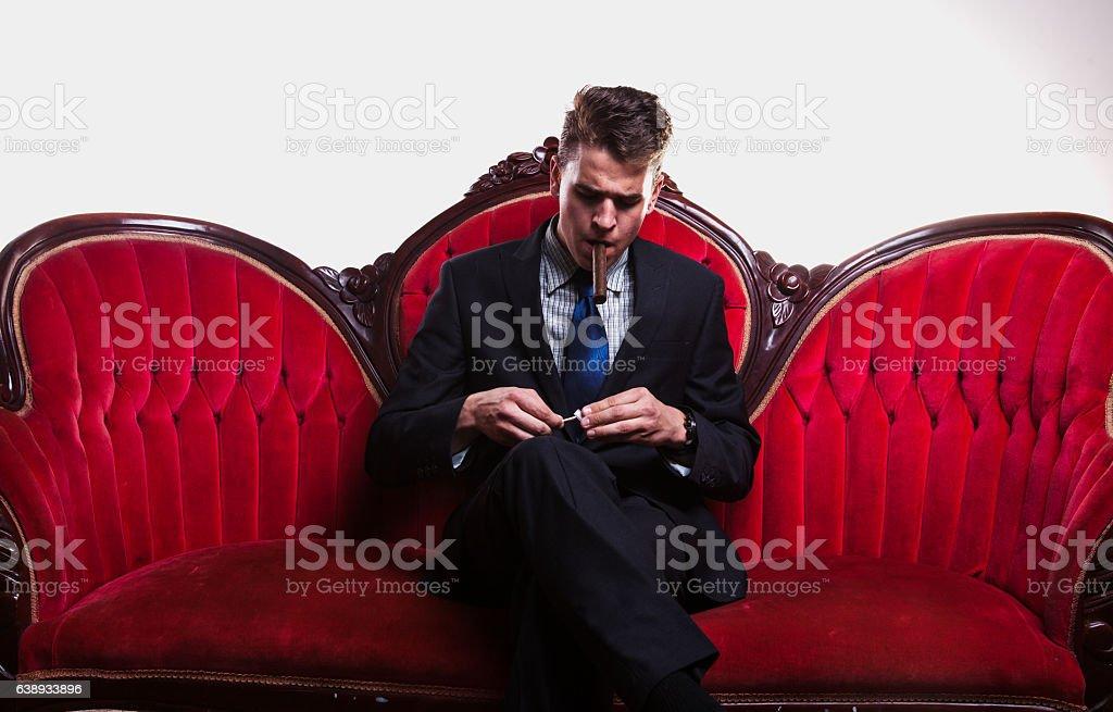 Wealthy Young Man Smoking Cigar stock photo