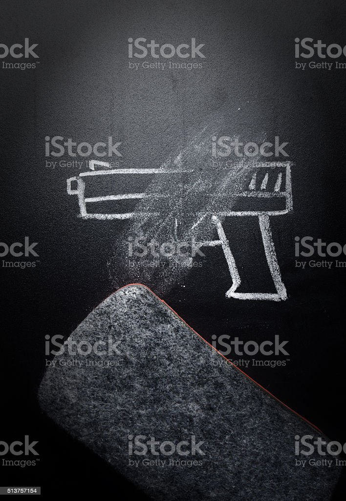 weapon draw erased on blackboard - no violence concept stock photo