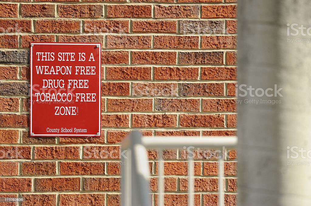Weapon drug and tobacco free school zone sign royalty-free stock photo