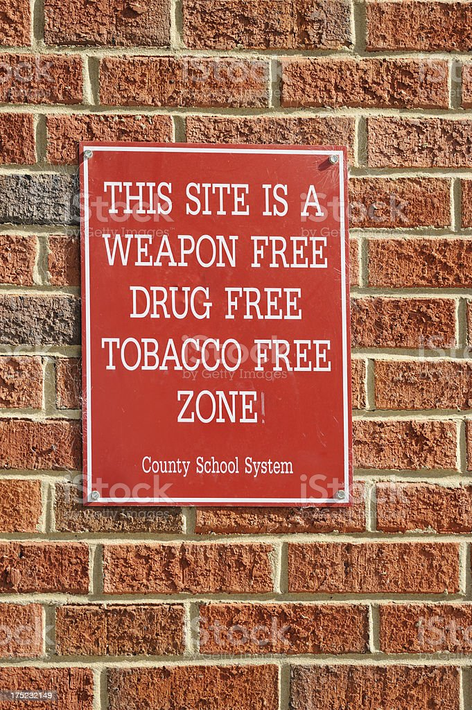 Weapon free drug tabacco zone at school stock photo