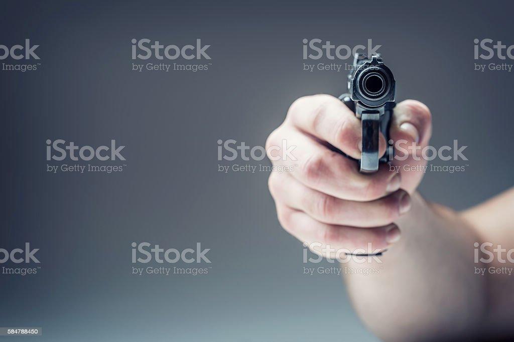 Weapon gun. Men's hand holding a gun. 9 mm pistol stock photo