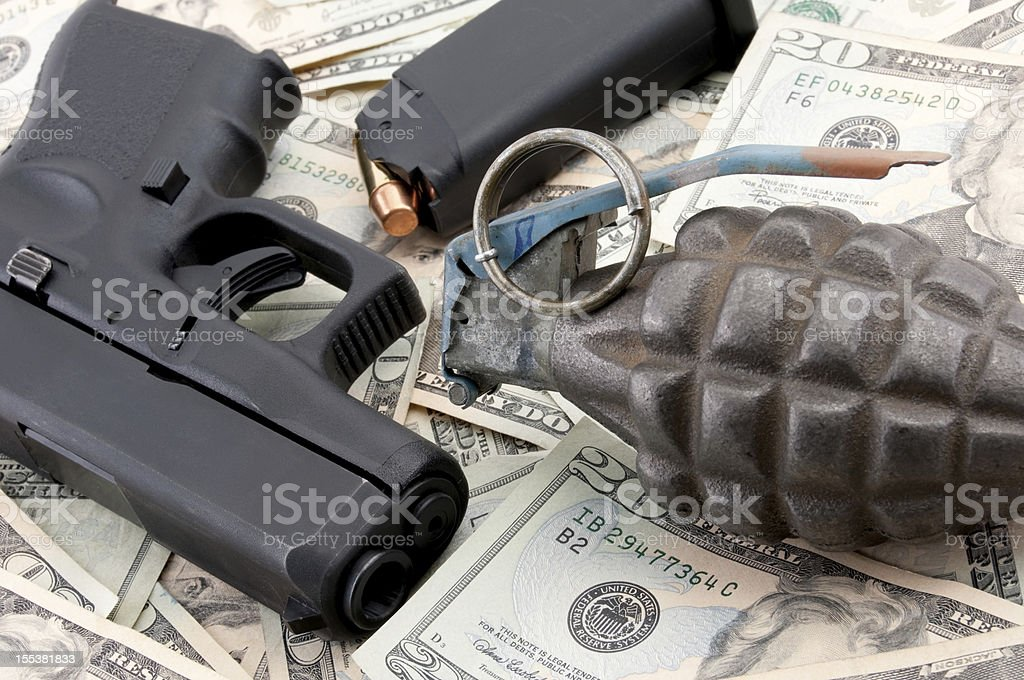 Weapons and currency stock photo