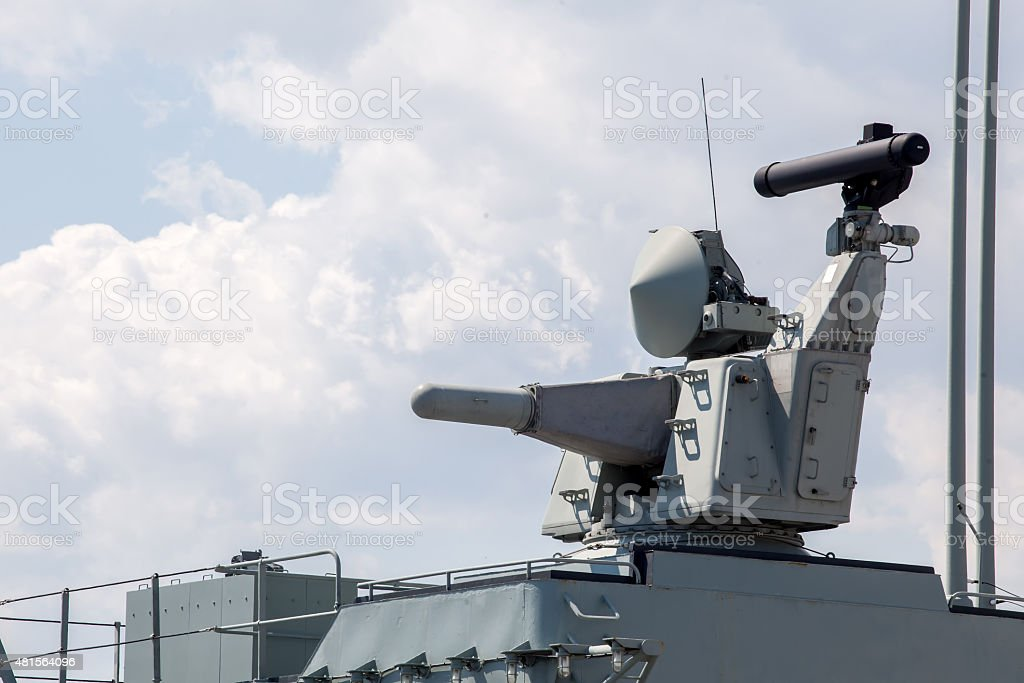 weapons on deck of a military ship. system for defense stock photo