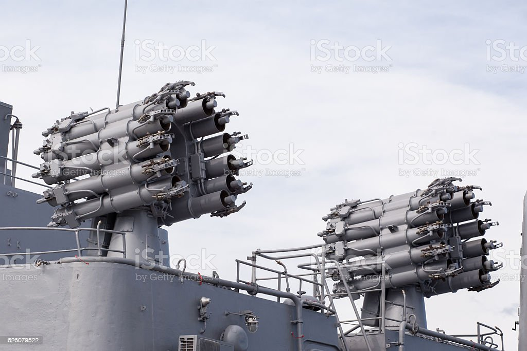 Weapons on deck of military ship. Weapon system for defense stock photo