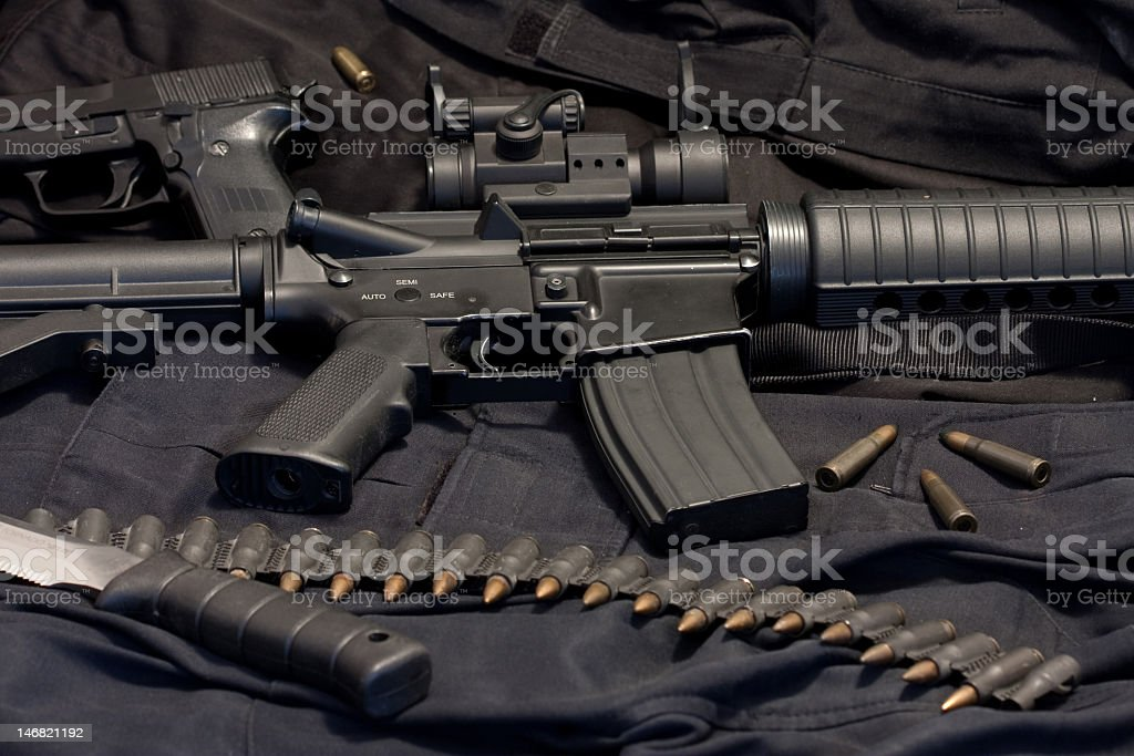 Weapons spread with handgun, M4, knife, and ammo stock photo