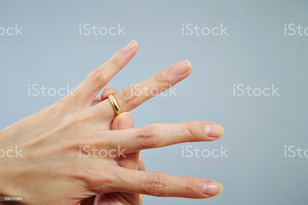 Wearing a gold ring stock photo