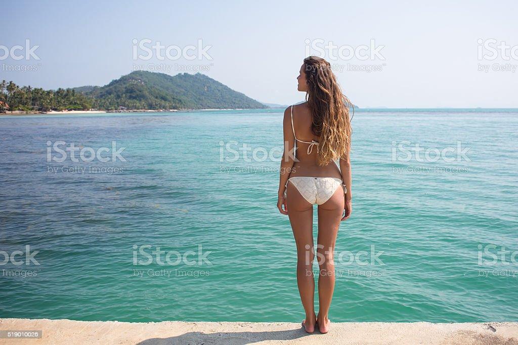 wearing bright jewelry of bikini stock photo