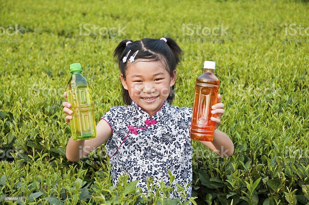 Wearing cheongsam Chinese little girl Hold tea drinks stock photo