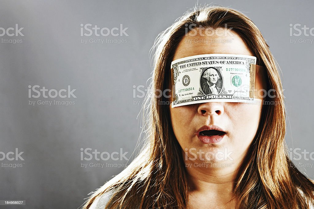 Wearing dollar bill blindfold young woman seems shocked stock photo