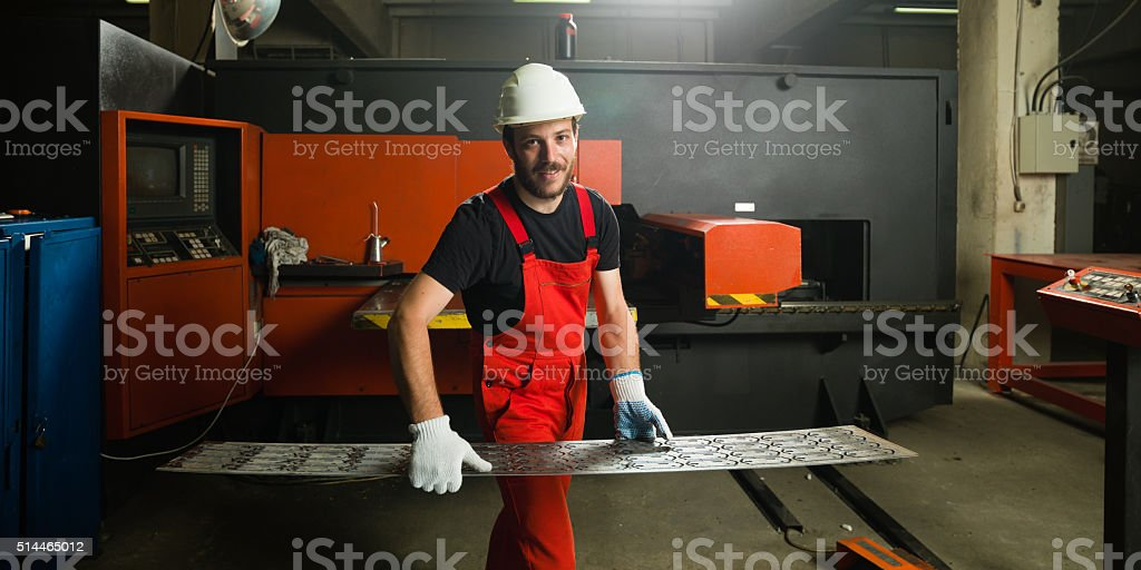 wearing red overalls stock photo