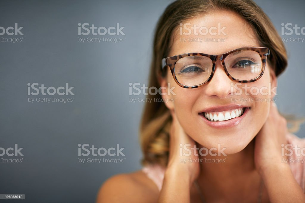 Wearing stylish specs and a spectacular smile stock photo