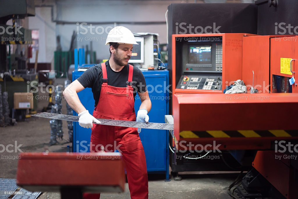 wearing white protective helmet and gloves stock photo