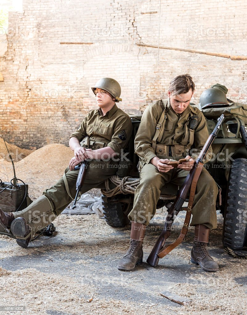 Weary WWII Army Solder Reading Bible in a Quiet Moment stock photo