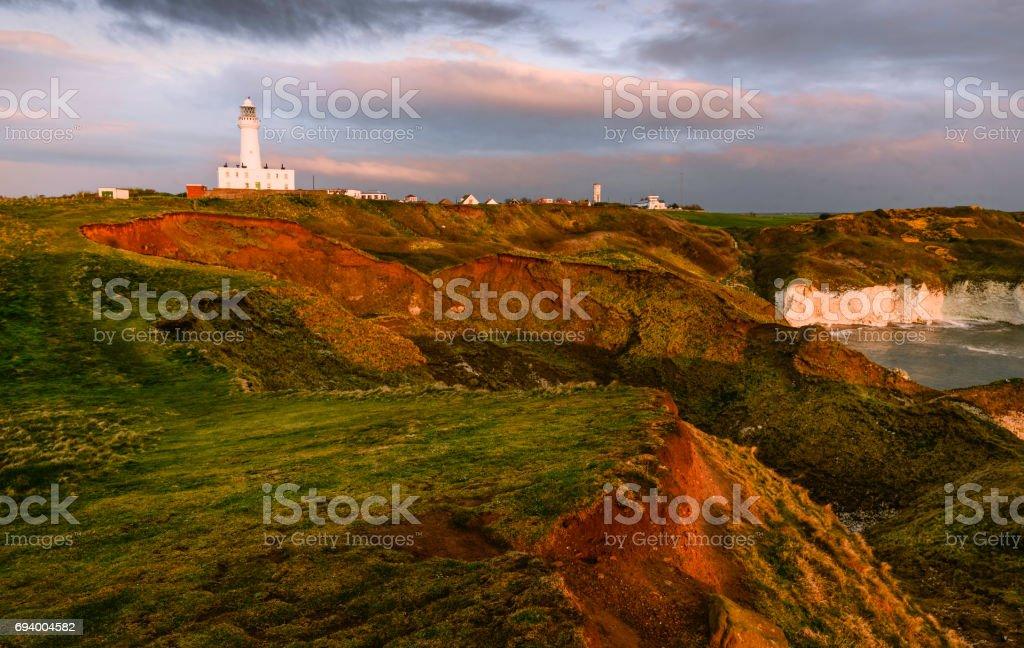Weather and sea erosion near Lighthouse, Yorkshire, UK. stock photo