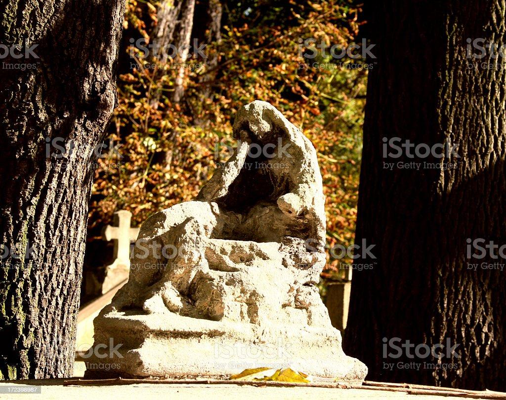 weather beaten sculpture on cementary stock photo