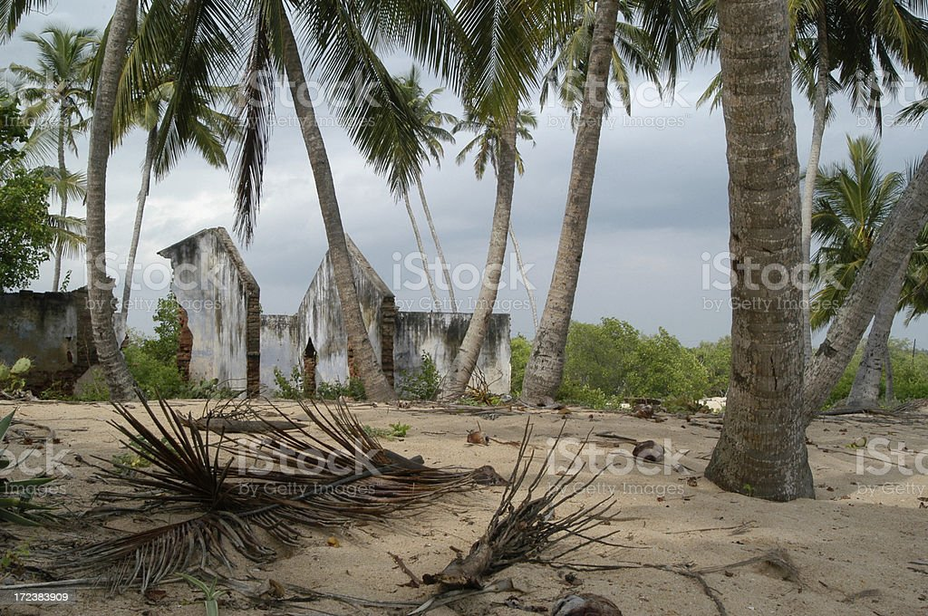 Weather Damaged Buildings by the Beach stock photo