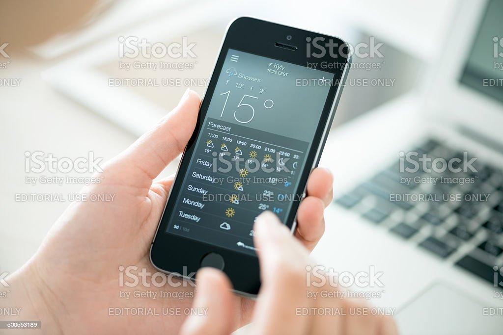 Weather forecast on Apple iPhone 5S stock photo