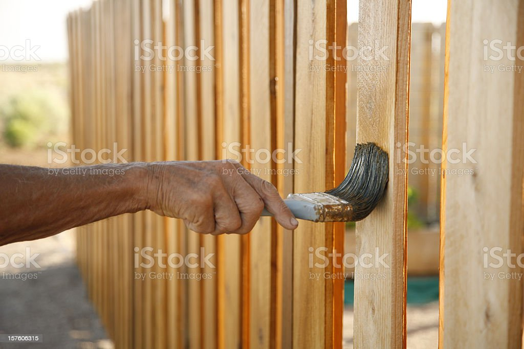 Weather Proofing a Fence royalty-free stock photo