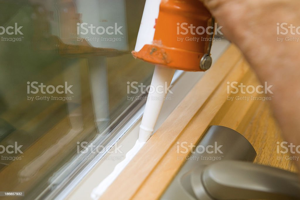 Weather Seal Caulk being applied to Window Frame stock photo