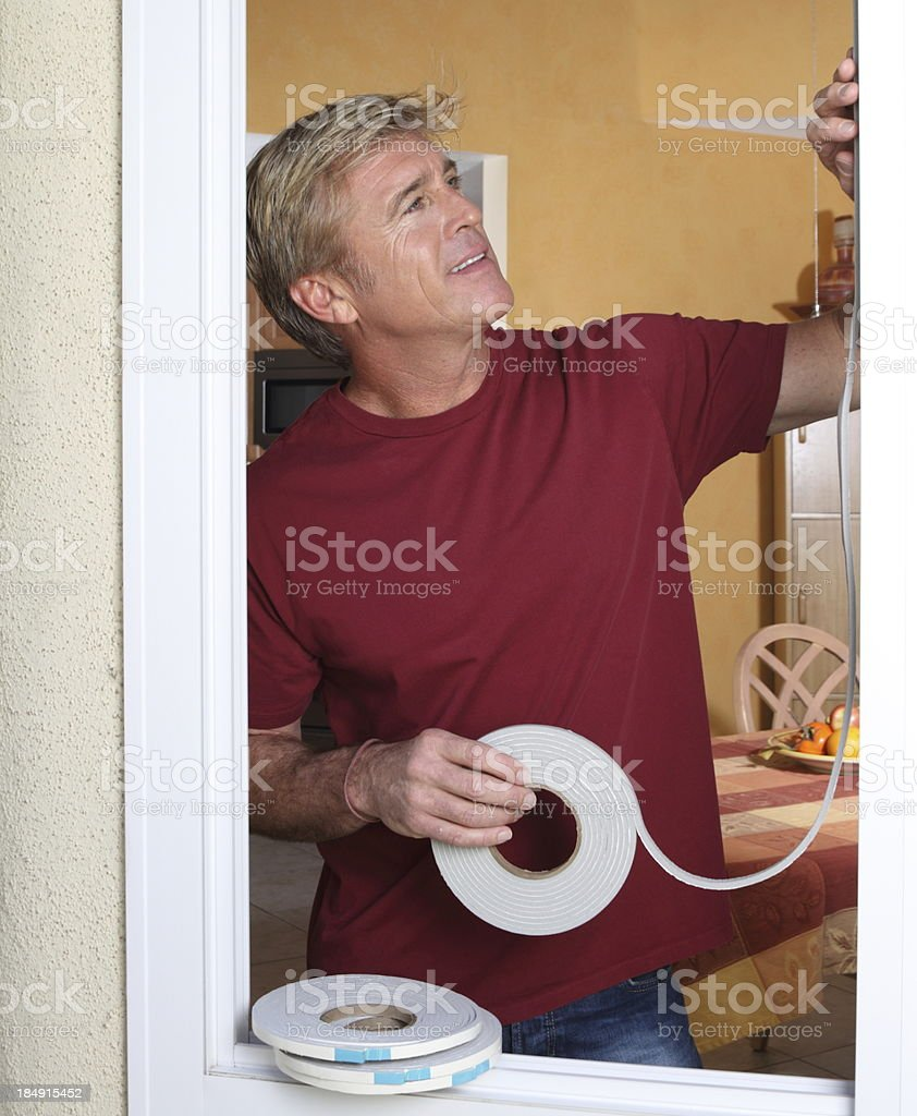 Weather Stripping Man MS stock photo