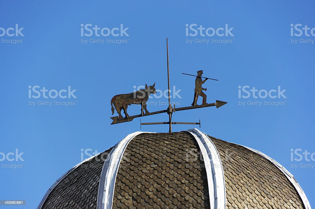 weather vane against blue sky royalty-free stock photo