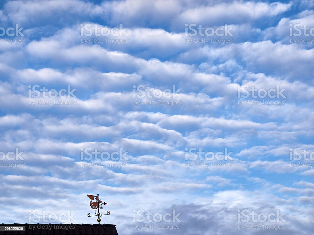 Weather vane and a cloudy sky stock photo