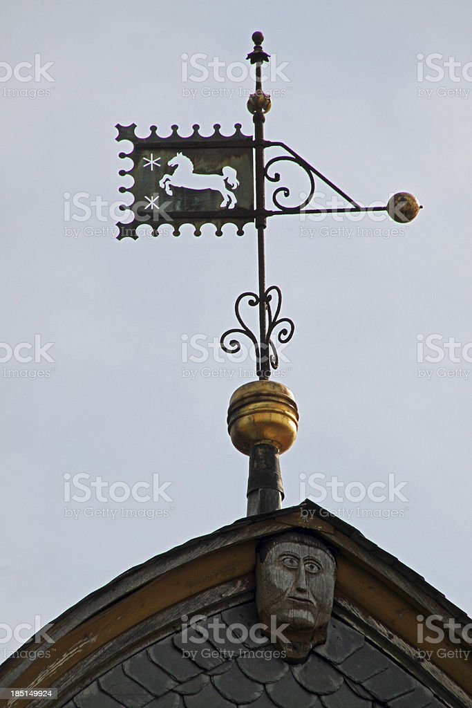 Weather vane on a roof in Bad Gandersheim royalty-free stock photo