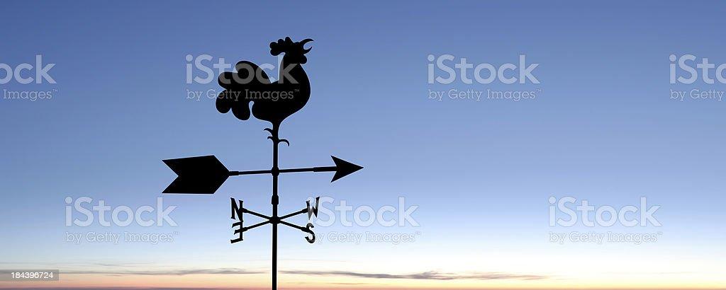 XXXL weather vane silhouette stock photo