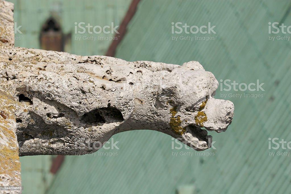 Weather-beaten old Gargoyle stock photo