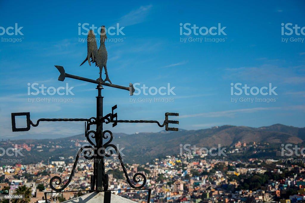 weathercock overlooking the city stock photo