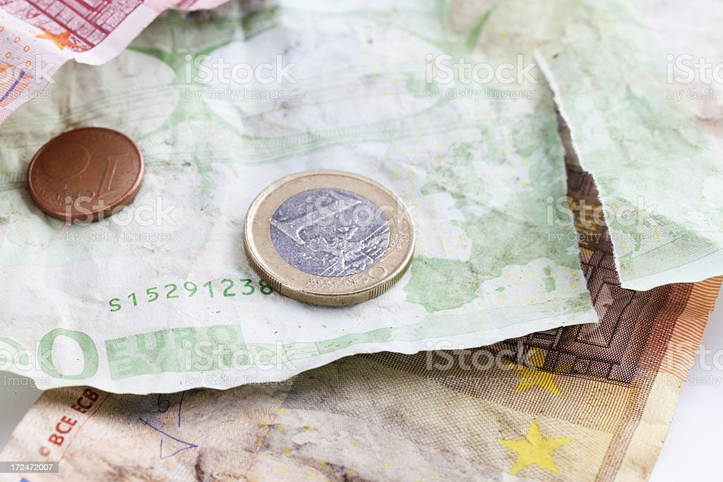 weatherd euro notes and coins stock photo