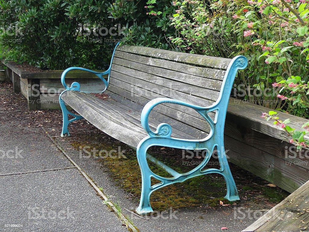 Weatherd park bench stock photo