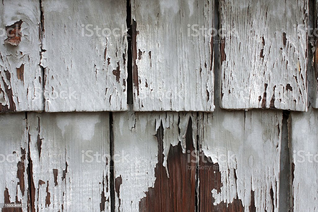 Weathered And Chipped Wood Shingles On Side Of Building royalty-free stock photo