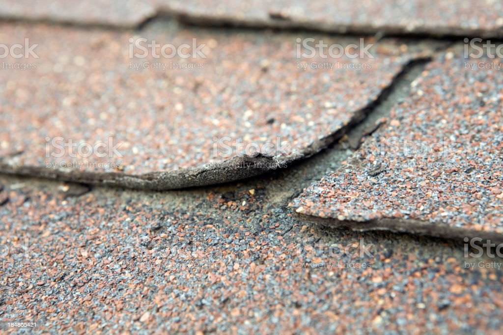 Weathered and Damaged House Shingle stock photo