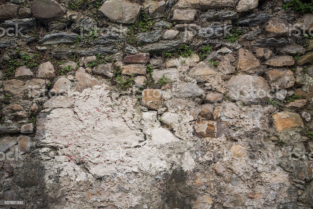 Weathered and decayed stone wall stock photo