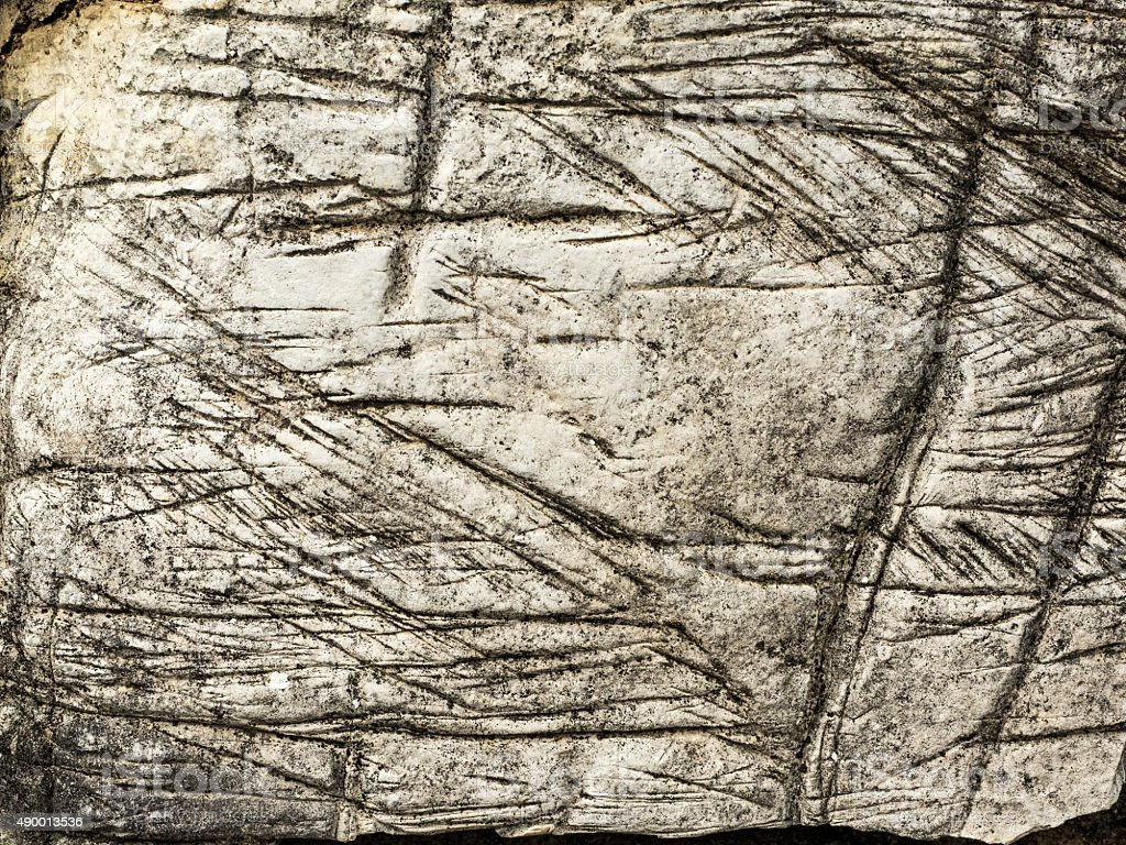 Weathered and Etched Light-Colored Rock stock photo