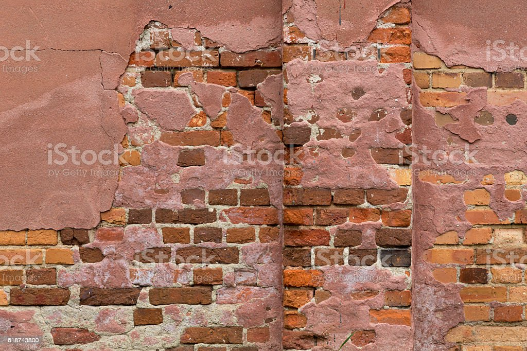 Weathered brick wall as background or texture stock photo