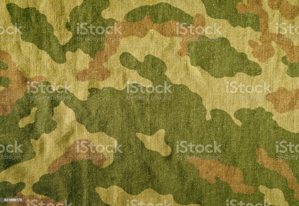 Weathered camouflage cloth texture stock photo
