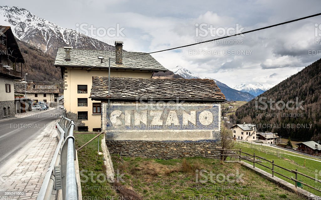 Weathered Cinzano sign on a wall, Aosta Valley Italy stock photo