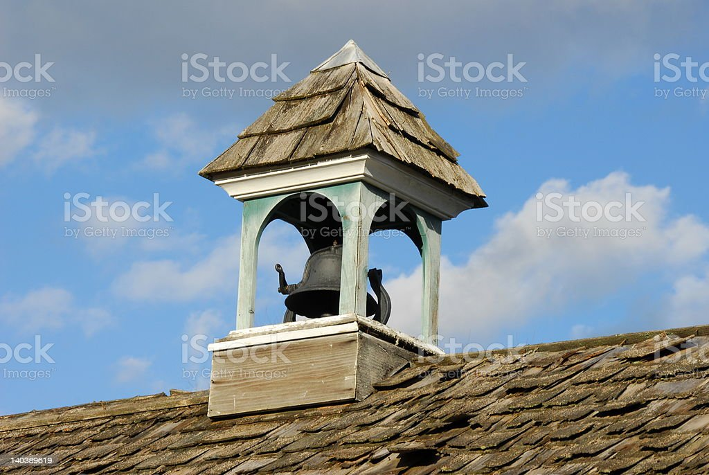 Weathered cupola or belfry with bell stock photo