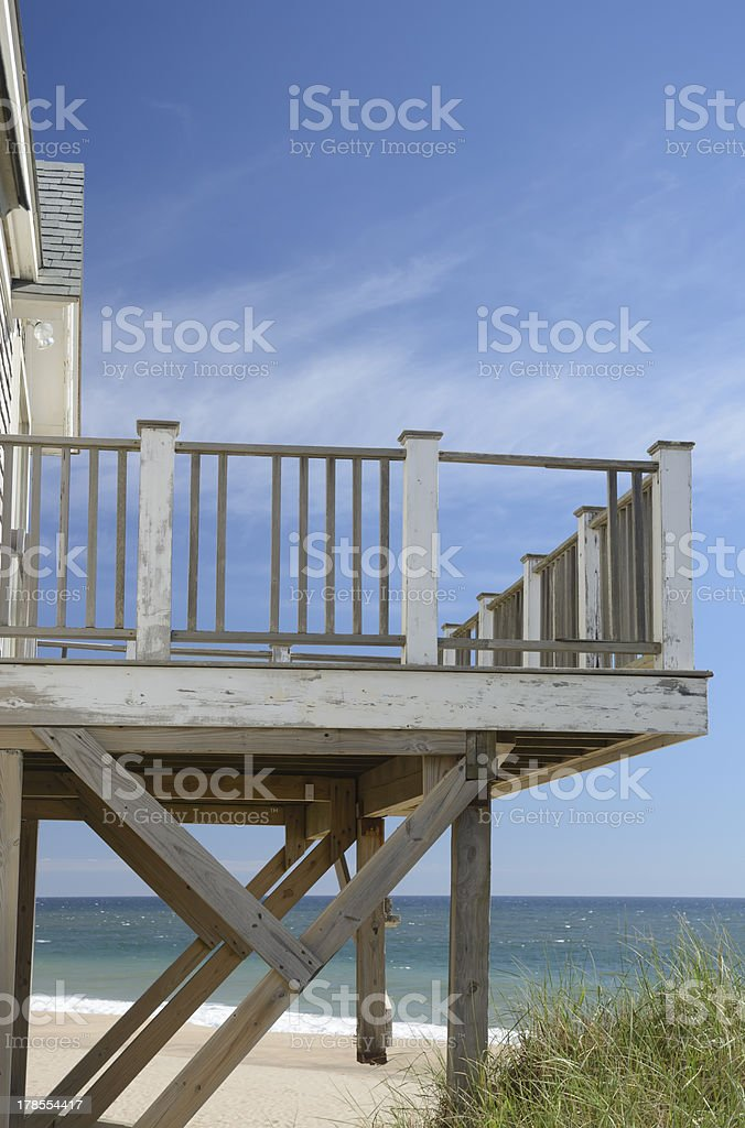 Weathered deck of beach house susceptible to heavy storms royalty-free stock photo