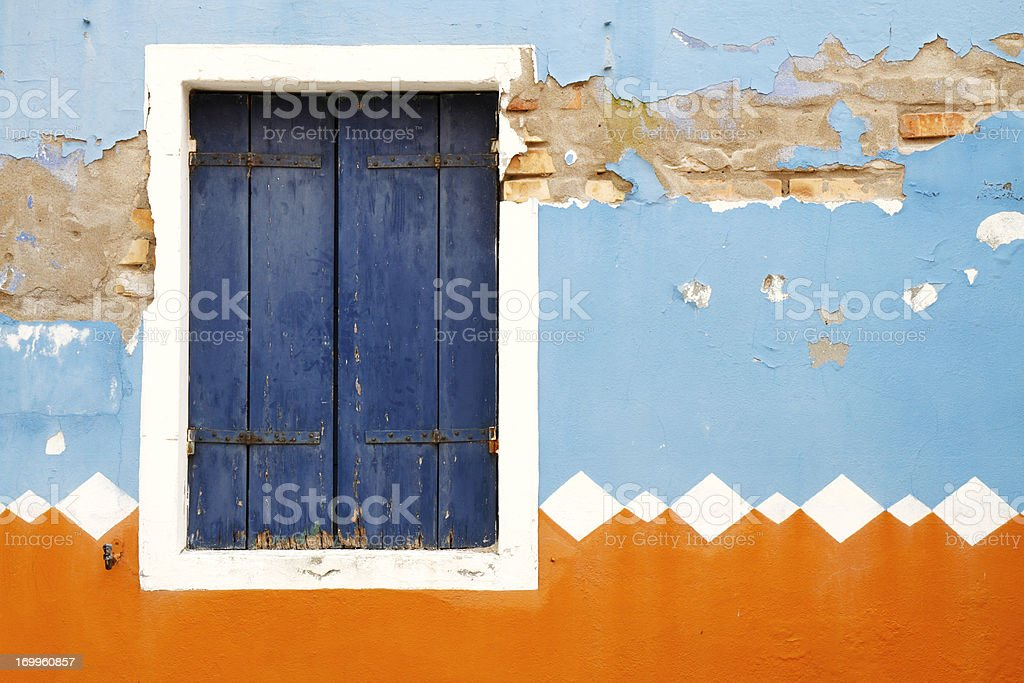 Weathered decorated facade with window royalty-free stock photo