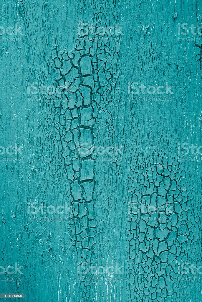 Weathered deep blue green teal painted cracked organic wall texture royalty-free stock photo
