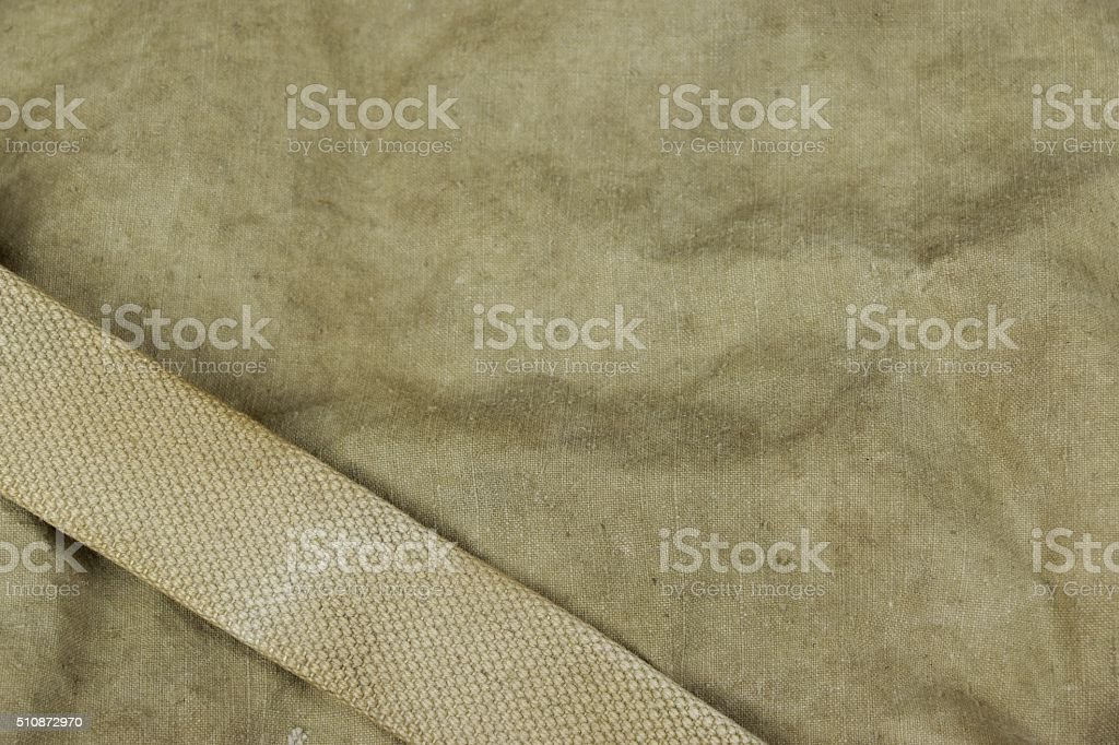 Weathered Faded Military Army  Khaki Camouflage With Belt. Backg stock photo