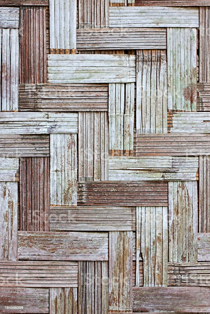 Weathered herring-bone woven bamboo background. royalty-free stock photo