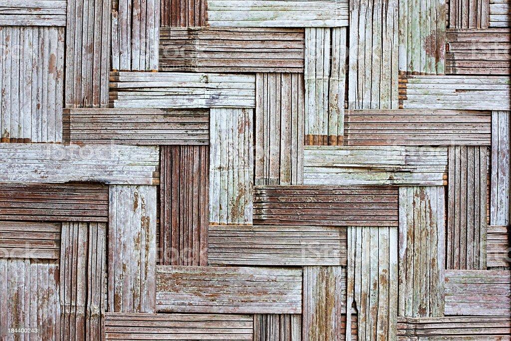 Weathered herring-bone woven bamboo background. royalty-free stock photo