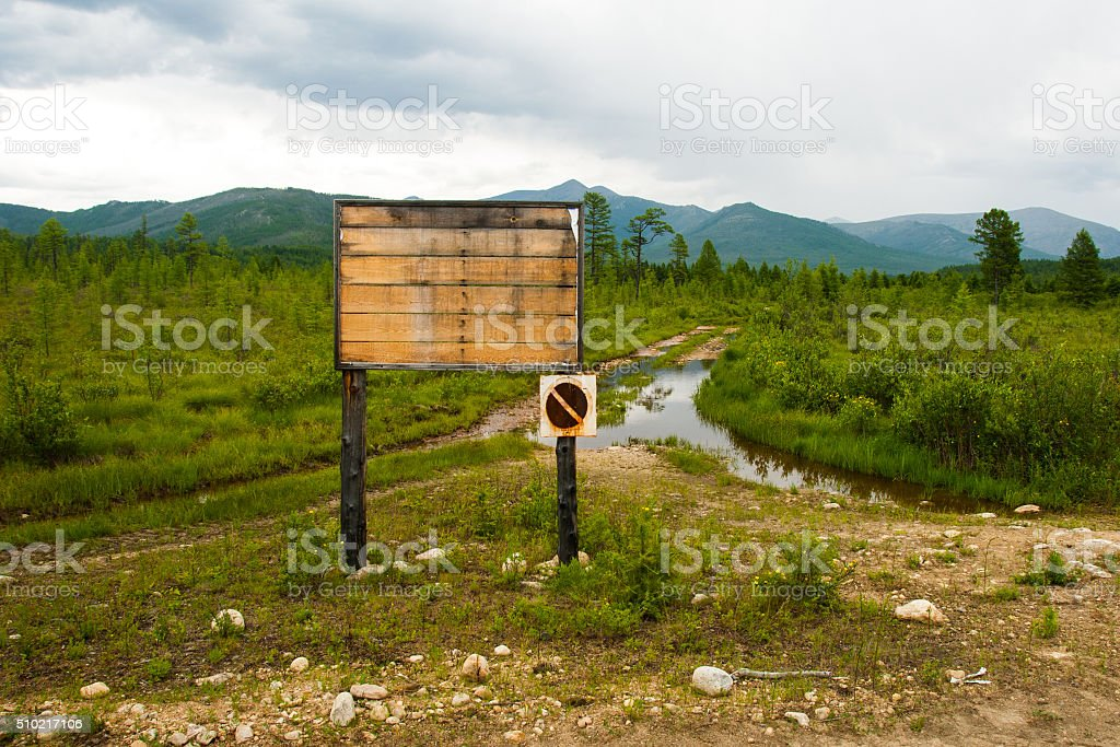 Weathered information board stock photo